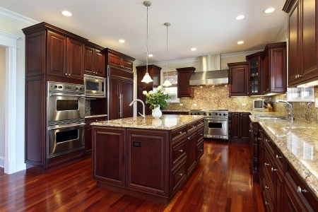 Luxury ranch style home kitchen with high end appliances and a granite kitchen counter top.