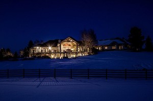 7250 Fox Creek Trail luxury horse ranch in Frankton CO for sale. Nighttime snowy photo.