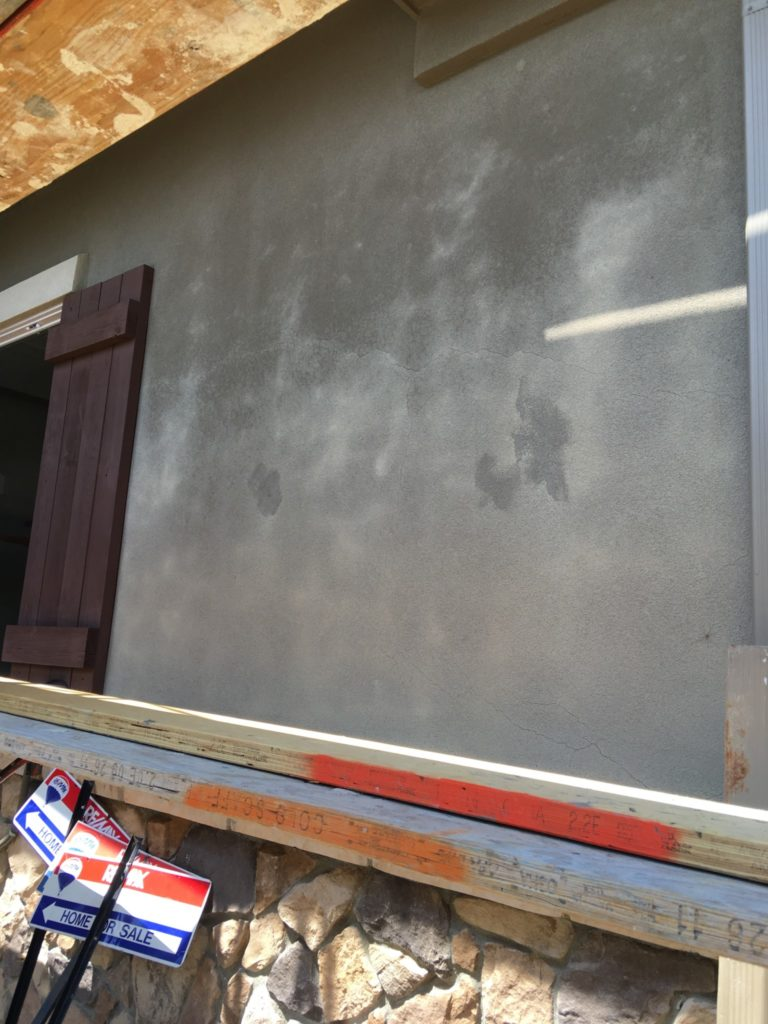 Stucco discoloration and cracks